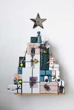 Our pin selection of creative ways to decorate your home with old Christmas cards. This one requires ribbons to make your cards look like presents stacked into the form of a Christmas tree. Merry decorating! http://www.photobookworldwide.com/create-cards/category/christmas