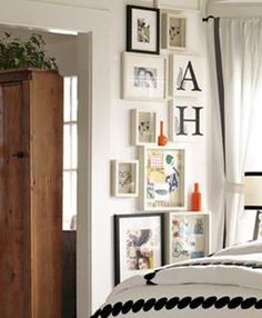 Great wall decoration for a tween room from PBteen.  Mixing black and white frames with bold letters and pictures makes it fun and interesting.