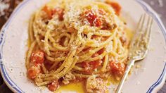 Pasta with a chilli, bacon and tomato sauce (bucatini all 'amatriciana) | This recipe, which originated in Amatrice, near Rome, was taken to heart by Roman chefs and has now become familiar all over the world. It is simple itself to make, but you must use bucatino – a large spaghetti-type pasta with a hole in the middle, which makes it easy to cook. You should also use guanciale, cured pig cheek, although you could substitute the less tasty pancetta. Use pecorino cheese here rather than the…