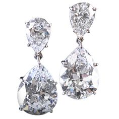 Magnificent Pair of Diamond Drop Earrings  London  Contemporary  Magnificent pair of diamond earrings, the pear-shaped diamonds weighing 4.03ct and 4.05ct. Each claw set in platinum and hung from pear-shaped diamond surmounts.  Price  $150,000