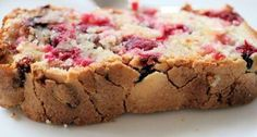 Place the milk 1 of the eggs butter flour sugar orange zest salt dried cranberries and yeast in the bread machine pan in the order recommended by the...