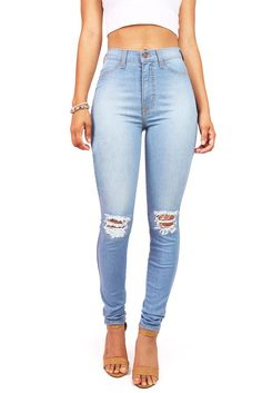 Light-wash faded high waist skinny jeans with small tearing around the knees. Faux front pockets with pockets in the back. Zipper and button fly. *Machine Wash Cold *68% Cotton 23% Modal 7% T400 1.2%