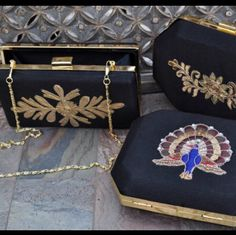 Brand new black and gold luxury box clutches. Designer items at not so designer prices! Only one of each design available.
