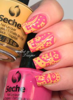 Bold, bright watermarble nail art with floral accents