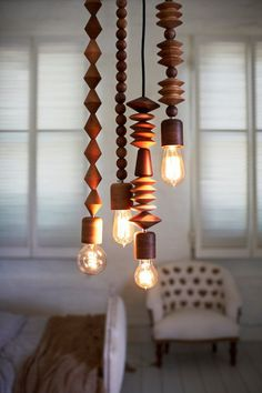 Buy the $8 lamp repair kit at ace, use some of those big beads that will fit over the cord and hang these from the ceiling in the restaurant: