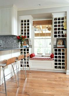 Kitchen Remodeling How to: Fab window seat and wine storage combo in this !
