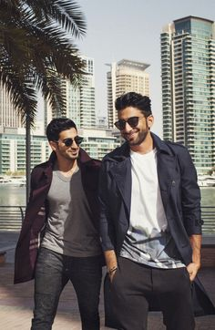 Entrepreneurs Anas and Harith Bukhash wearing Burberry trench coats at Dubai Marina for Art of the Trench Middle East