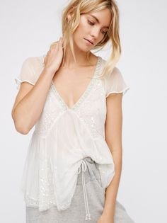 Golden Light Embellished Top | Sheer top with an ethereal feel and femme babydoll fit. Features beautiful embellishments throughout. V-neckline with a crisscross back detail. Easy, flowy sleeves.