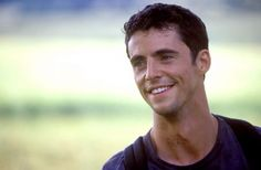Matthew Goode. It's mostly the grin, but the British accent doesn't hurt.