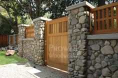 love the idea of having some sort of stone wall and fence around your house