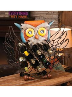 "Owl Wine Bottle Holder from WineRacks.com for $101.00  Dimensions: 25""w x 7.75"" d x 22"" h Capacity: 8 bottles  This colorful piece of metal art will also store your wine!"
