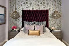 From the floral wallpaper to the deep burgundy custom headboard, everything in this room is exciting