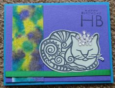 Michael Strong cat stamp, club scrap sentiment and paper. Baby wipe/alcohol ink technique