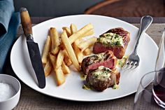 Cafe de Paris butter  #recipe  200g butter, at room temperature  1 garlic clove, crushed  2 drained anchovy fillets, finely chopped  2 teaspoons Dijon mustard  1 teaspoon baby capers, rinsed, drained  1 tablespoon chopped fresh chives  1 tablespoon chopped fresh continental parsley    Seared steak slathered with seasoned butter is a French bistro favourite.