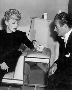 """Marlene Dietrich and John Wayne in a game of #chess on the set during a shooting break. They starred in two movies together, """"Seven Sinners,"""" (1940) and """"The Spoilers,"""" (1942)."""