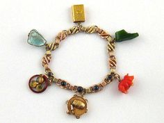 A fine pre revolution Russian hallmarked 14 carat three colour gold and cabochon sapphire charm bracelet, sold for £2,200.