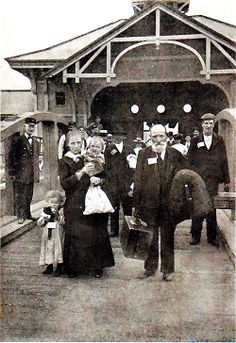 NYC. Immigrants in 1904 after being processed at Ellis Island. Welcome to your new life!