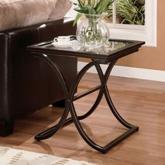 Southern Enterprises Vogue End Table - What We Like About This End Table The Vogue End Table will bring a pleasantly distinct style to your home. The metal frame is finished in black with t...