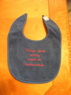 Baby Bib These Idiots Put My Cape On Backwards by SheriMomto4