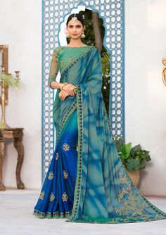 Royal blue and moss green saree with blouse. Work - Embroidered patch border on saree with embroidery and stones on blouse. Paired with the matching blouse piece.Please Note: The shades may vary Designer Sarees Collection, Saree Collection, Indian Wedding Fashion, Indian Fashion, Kimono Fashion, Fashion Outfits, Fasion, Netted Blouse Designs, Party Wear Sarees Online