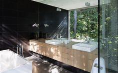 sleek-slope-house-with-interior-featuring-concrete-16-bathroom-sinks.jpg