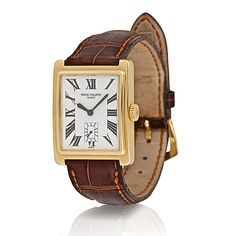 PATEK PHILIPPE: 'GONDOLO' 18 K YELLOW GOLD WRISTWATCH - Mens 18 K yellow gold rectangular wristwatch, back secured by 4 screws, ref. 5010, 18 jewel 8 adjustment manual wind movement cal. 215, white enamel dial with black enamel Roman numerals, black leaf-shaped hands, subsidiary seconds chapter at the 6 o'clock position, sapphire crystal, attached to a signed brown alligator strap with a signed 18 K yellow gold buckle, c. 1996, 25 mm x 33 mm