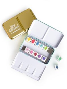 http://www.michaels.com/jane-davenport-petite-palette-brights/10503026.html#q=Jane+Davenport&start=19   Paint your canvas scrapbook cover with this petite palette by Jane Davenport. These bright watercolors are perfect to personalize your handmade cards, gift bags and other papercraft projects. They come in a convenient metal case for easy storage.