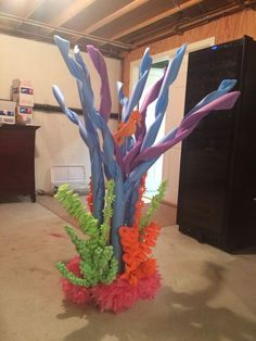 This is a coral reef made for the The Little Mermaid Jr. The bulk of it is from pool noodles, foam flowers, and the lower flowers are from plastic table cloths.: