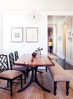 8 Easy (and Genius!) Ways to Kid-Proof Your Home // living edge dining table, burlap bench, dining room, bamboo dining chair, animal print rug