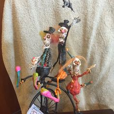 Halloween skelly clowns riding bike