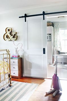 Barn Door look using a traditional door & off the shelf hardware that won't break the bank!