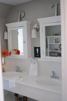 Gray & white bathroom. Double medicine cabinets.