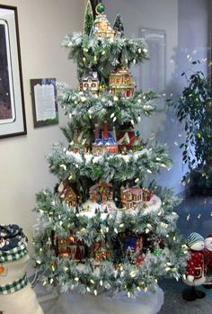 Christmas village display as a Christmas tree! Noel Christmas, Country Christmas, Christmas Projects, Winter Christmas, Christmas Ornaments, Painted Christmas Tree, Rotating Christmas Tree, Christmas Tree Train, Christmas History