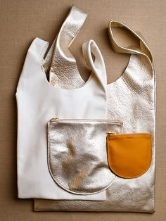 """ᔥ #Baggu #hobobags are #leather that is """"naturally milled"""" in Argentina. I, of course, like the gold one."""