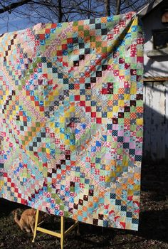 olive and ollie: a finished scrappy trip around the world quilt top