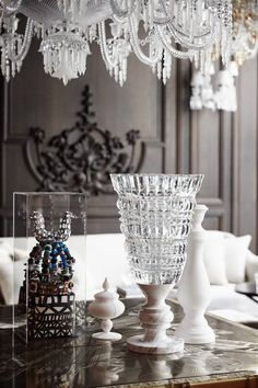 A table set with lead crystal and objets in the Baccarat Hotel's Petit Salon, which also has a vintage gramophone and vinyl records.