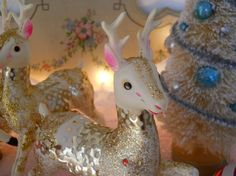 fabulous 1950s vintage glitzy reindeer, vegas style gold lame, matched pair, pink, gold, white, made in japan, glitz and glitter OOAK. $60.00, via Etsy.