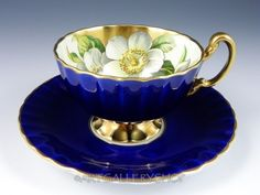 Vintage Aynsley England COBALT BLUE GOLD TRIM MAGNOLIA FLOWER TEA CUP AND SAUCER. eBay $99.00