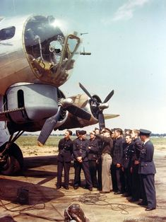 Captain points out features of B-17 to English Air Training Cadets at a base in England.