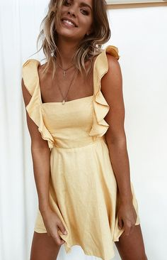 Loving all things mustard with the Denny Dress Mustard. This beautiful dress features adjustable spaghetti straps with front frilling material, tie up back, invisible back zip from bra strap to bottom back, an a line skirt design and a slightly heavier cotton material. This dress pairs well with some tassel earrings an