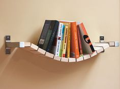 But really now... It's cool and all but do you think it's the most effective bookshelf? Put one too many on it and.. down falls Humpty Dumpty off the wall.
