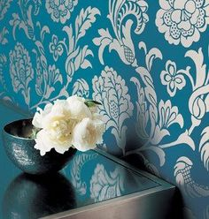 I would love to do a bathroom in this wall paper! Or perhaps a huge focal point project...hmmm...