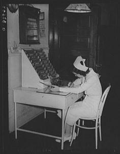 Nurse writing up charts Herrin Hospital, Illinois 1939 I remember metal charts and chart racks