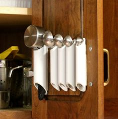 PVC pipe for kitchen organizing by Ashbee Design, measuring spoons and cups