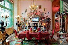 An altar mosaic incorporating TV for travel souvenirs. L'appartement intime de Pierre et Gilles. Cote Maison