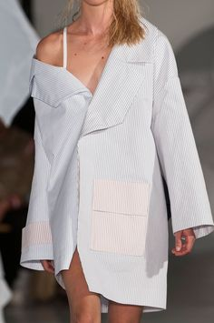 Jacquemus, Spring 2015; the placement of print within this garment is extremely effective. The use of a simple pinstripe creates balance within the asymmetry of this silhouette.  image via- stylebistro.com