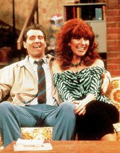 Ed O'Neill as Al Bundy and Katey Sagal as Peggy Bundy (Married... with Children)