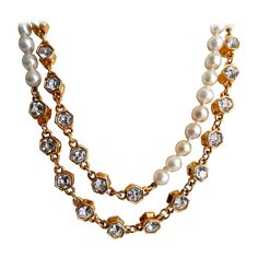 Chanel Pearl and Rhinestone Sautoir/Necklace | From a unique collection of vintage beaded necklaces at https://www.1stdibs.com/jewelry/necklaces/beaded-necklaces/