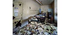 Abandoned with all the files and photos still in the drawers. Highland Park Police Station, Detroit. French photographers Yves Marchand and Romain Meffre set out to document the decline of an American city.