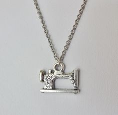 Sewing Machine Necklace in Silver  by BelieveInGoodKarma on Etsy, $9.00